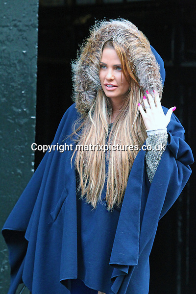 EXCLUSIVE ALL ROUND PICTURE:  TREVOR ADAMS / MATRIXPICTURES.CO.UK<br /> PLEASE CREDIT ALL USES<br /> <br /> WORLD RIGHTS<br /> <br /> English media personality, reality television star, model and businesswoman Katie Price is spotted leaving her lawyers' office in Central London, England. <br /> <br /> The former glamour model appears relaxed and casual, sporting an oversized blue smock-style cape with a fur hood, bright blue jeans and furry boots to match.<br /> <br /> JANUARY 16th 2014<br /> <br /> REF: MTX 14223