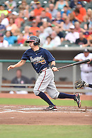 Mississippi Braves catcher Braeden Schlehuber #11 swings at a pitch during a game against the Tennessee Smokies at Smokies Park on July 21, 2014 in Kodak, Tennessee. The Braves defeated the Smokies 4-3. (Tony Farlow/Four Seam Images)