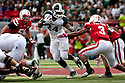 29 October 2011: Le'Veon Bell #24 of the Michigan State Spartans rushes up the middle against the Nebraska Cornhuskers at Memorial Stadium in Lincoln, Nebraska.  Nebraska defeated Michigan State 24 to 3.