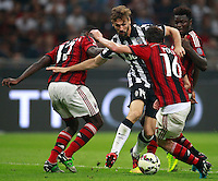 Calcio, Serie A: Milan vs Juventus, Milano, stadio San Siro, 20 settembre 2014.<br /> Juventus forward Fernando Llorente, of Spain, second from left, is challenged by AC Milan defender Cristian Zapata, of Colombia, AC Milan midfielders Andrea Poli, second from right, and Sulley Ali Muntari, of Ghana,  during the Italian Serie A football match between AC Milan and Juventus at Milan's San Siro stadium, 20 September 2014.<br /> UPDATE IMAGES PRESS/Isabella Bonotto