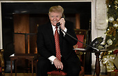 United States President Donald J. Trump participates in NORAD Santa Tracker phone calls in the East Room of the White House in Washington, D.C on December 24, 2018.<br /> Credit: Olivier Douliery / Pool via CNP