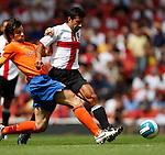 Inter Milan's Luis Figo challenged by Valencia's David Albelda.Pic SPORTIMAGE/Simon Bellis