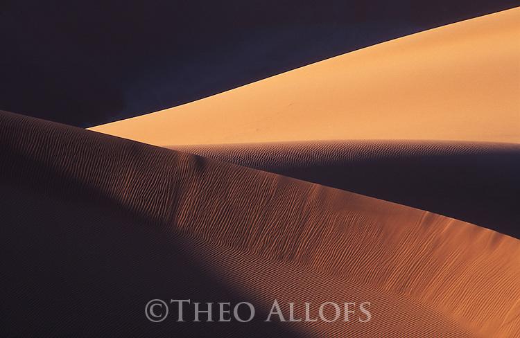 Sand dunes at sunset near Sossusvlei; Namib-Naukluft National Park, Namib Desert, Namibia