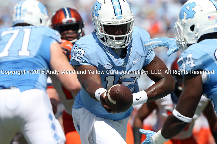 19 September 2015: UNC's Marquise Williams (12) hands off to Elijah Hood (34). The University of North Carolina Tar Heels hosted the University of Illinois Fighting Illini at Kenan Memorial Stadium in Chapel Hill, North Carolina in a 2015 NCAA Division I College Football game. UNC won the game 48-14.