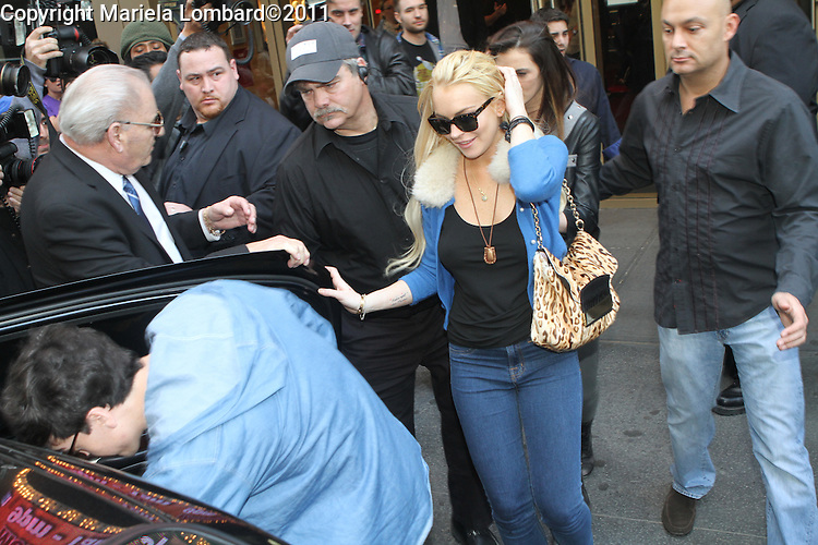 Lindsay Lohan leaving 222 West 44th. St. in Times Square today.