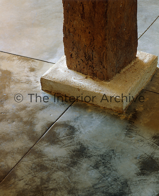 Old and new come together where the  base of an original wooden pillar meets the polished concrete floor