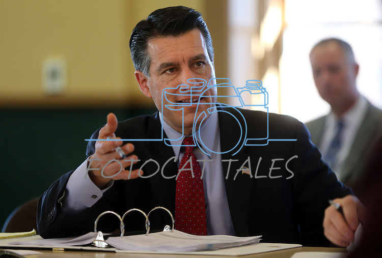 Nevada Gov. Brian Sandoval works in a Board of Examiners meeting at the Capitol in Carson City, Nev., on Tuesday, Feb. 12, 2013..Photo by Cathleen Allison