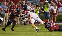 Hawgs Illustrated/BEN GOFF <br /> T.J. Brunson (left) and Eldridge Thompson, South Carolina linebackers, tackle Austin Cantrell, Arkansas tight end, in the third quarter Saturday, Oct. 7, 2017, at Williams-Brice Stadium in Columbia, S.C.