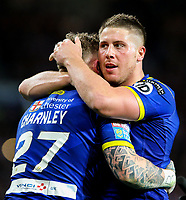 Warrington Wolves' Josh Charnley is congratulated by Tom Lineham after open the scoring<br /> <br /> Photographer Alex Dodd/CameraSport<br /> <br /> Betfred Super League Grand Final - Wigan Warriors v Warrington Wolves - Saturday 13th October 2018 - Old Trafford - Manchester<br /> <br /> World Copyright &copy; 2018 CameraSport. All rights reserved. 43 Linden Ave. Countesthorpe. Leicester. England. LE8 5PG - Tel: +44 (0) 116 277 4147 - admin@camerasport.com - www.camerasport.com