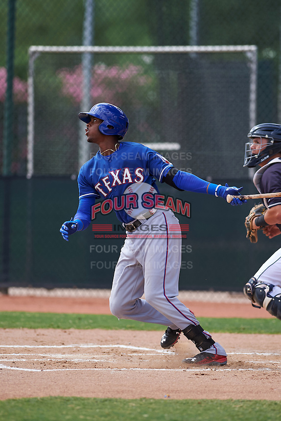 Texas Rangers Ti'Quan Forbes (77) during an instructional league game against the Seattle Mariners on October 5, 2015 at the Surprise Stadium Training Complex in Surprise, Arizona.  (Mike Janes/Four Seam Images)