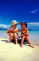 A young boy and girl ( age 7 ) love to  play on the beautiful beaches of Hawaii. This photo taken on Waimanalo Beach, Oahu.