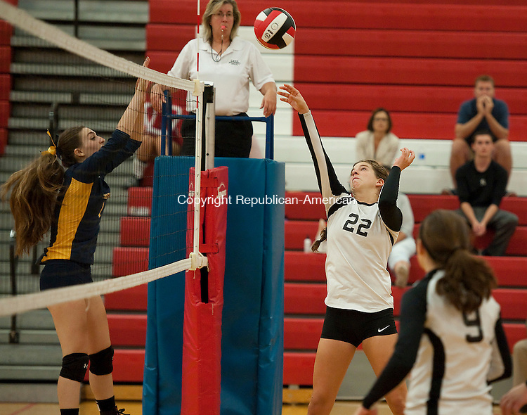 SOUTHBURY, CT--- -092815JS18---Pomperaug's Rachel Bonnanzio (22) pits the ball over the net in front of Weston's Madison Sakin (1) during their match Monday at Pomperaug High School in Southbury. Pomperaug defeated Weston 3-2. Jim Shannon Republican-American