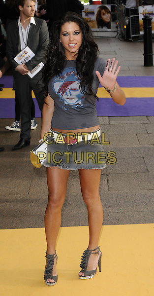"BIANCA GASCOIGNE.UK Premiere of ""Hannah Montana: The Movie"" at the Odeon Leicester Square, London, England..April 23rd 2009 .full length grey gray David Bowie t-shirt print denim mini skirt brown ruffles ruffled shoes sandals platform white belt clutch bag hand palm waving v peace sign writing no more drama words.CAP/CAN.©Can Nguyen/Capital Pictures."