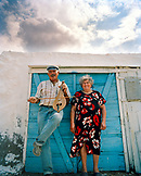 GREECE, Patmos, Diakofti, Dodecanese Island, portrait of Mihalis with his lyra and his wife Katerina Grillakis at their restaurant, Diakofti Taverna