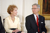 Former First Lady Nancy Reagan and Fred Rogers exchange smiles as United States President George W. Bush honors them as recipients of the Presidential Medal of Freedom during a ceremony in the East Room of the White House in Washington, DC on 9 July, 2002.<br /> Credit: Ron Sachs / CNP
