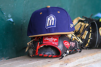 A San Antonio Missions hat sits on top of a glove in the dugout during a Pacific Coast League game against the Iowa Cubs on May 2, 2019 at Principal Park in Des Moines, Iowa. Iowa defeated San Antonio 8-6. (Brad Krause/Four Seam Images)