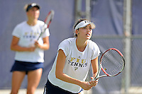 18 March 2012:  FIU's Sarah McLean waits for the serve during her doubles match against Columbia's Bianca Sanon and Tiana Takenaga as the Columbia Lions defeated the FIU Golden Panthers, 5-2, at University Park in Miami, Florida.