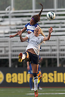 Boston Breakers forward Sydney Leroux (2) and Seattle Reign FC midfielder Kaylyn Kyle (6) battle for a crossed ball. In a National Women's Soccer League (NWSL) match, Seattle Reign FC (white) defeated Boston Breakers (blue), 2-1, at Dilboy Stadium on June 26, 2013.