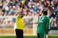 Referee Sorin Stoica gives a yellow card to Toronto FC goalkeeper Joe Bendik (12). Toronto FC and the Philadelphia Union played to a 1-1 tie during a Major League Soccer (MLS) match at PPL Park in Chester, PA, on April13, 2013.