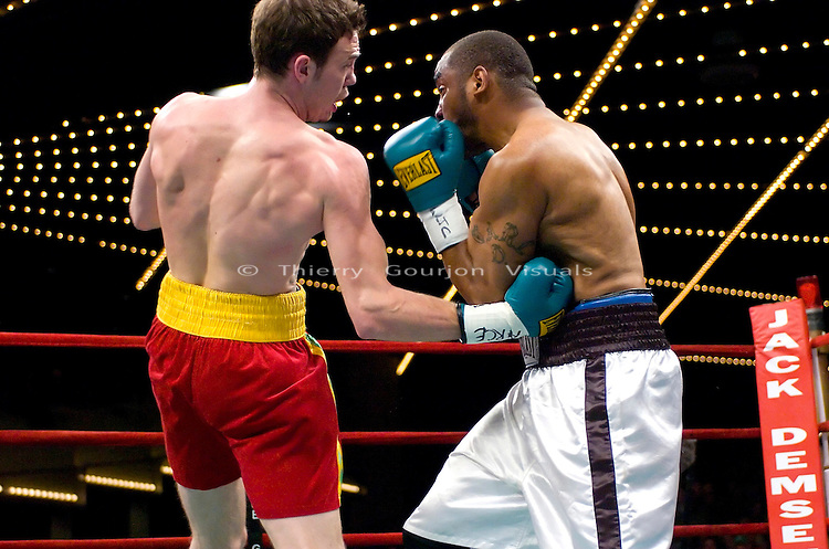 Andy Lee on the attack against  Carl Daniels during their  6 rounds Super Middleweights fight at Madison Square Garden in New York on  03.16.07. Lee won by a 3rd round knockout. Photo by Thierry Gourjon.