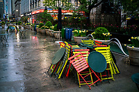 NEW YORK, NY - April 13:  Chairs are pilled in a public plaza due to COVID-19 during a rainy day on April 13, 2020. in New York, United States. The global economy is facing the worst collapse since the WWII, while COVID-19  pandemic has now killed more than 22,000 people in the United States and at least 1,864,629 people died world wide. (Photo by Eduardo MunozAlvarez/VIEWpress)