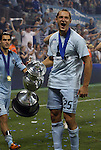 08 August 2012: Kansas City's Neven Markovic (BIH) (25) celebrates with the championship trophy. Sporting Kansas City won the championship over Seattle Sounders FC 3-2 on penalties after the game ended in a 1-1 tie at Livestrong Sporting Park in Kansas City, Kansas in the 2012 Lamar Hunt U.S. Open Cup Final.