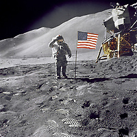 "1971-07-26, File Photo - Apollo 15 Commander Dave Scott salutes the American flag at the the Hadley-Apennine lunar landing site. The Lunar Module ""Falcon"" is partially visible on the right.<br /> <br /> Apollo 15 was the ninth manned mission in the Apollo program and the fourth mission to land on the Moon. It was the first of what were termed ""J missions"", long duration stays on the Moon with a greater focus on science than had been possible on previous missions. The mission began on July 26, 1971, and concluded on August 7th.<br /> <br /> Commander David Scott and Lunar Module Pilot James Irwin spent three days on the Moon and a total of 18¬Ω hours outside the spacecraft on lunar extra-vehicular activity. <br /> <br /> Image Credit: NASA"