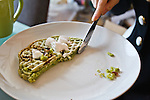 """In this photo made available on May 31, 2012 shows Mao Sugiyama eating his favorite Japanese green tea flavored waffles in his apartment in Kanagawa, near Tokyo, Japan, on May 29, 2012. Mao Sugiyama, 22, self-described as an asexual now just 2 months old, is a cartoonist, painter and illustrator living in Japan. Mao hated the idea of love and sex due to a series of past events relating to close people around him becoming victims of sexual crimes. In an effort to free himself from mankind, Mao underwent a surgical procedure in Tokyo to remove his male genitals and later serve them to paying guests at a small dinner event. He spent two years conducting extensive research about the removal of his genitals and had several sexual experiences with others prior to the surgery. The reasoning behind Mao's idea to host an event where he would cook his male parts and serve them to guests, was he needed to earn money to help cover the ongoing medical costs of the procedure. Five individuals consisting of men and women out of a small crowd who attended the dinner, ate Mao's specially cooked genitals. The men, however, were not able to completely finish eating the genitals as they grew disgusted whereas the women were able to finish everything on their plates entirely. The women commented on Mao's parts as """"delicious."""" With Mao being an artist that he is, his vision is to create beautiful art without the realization of being a man or woman and excluding love and sex out of his system completely. (Photo by Christopher Jue/Nippon News)"""