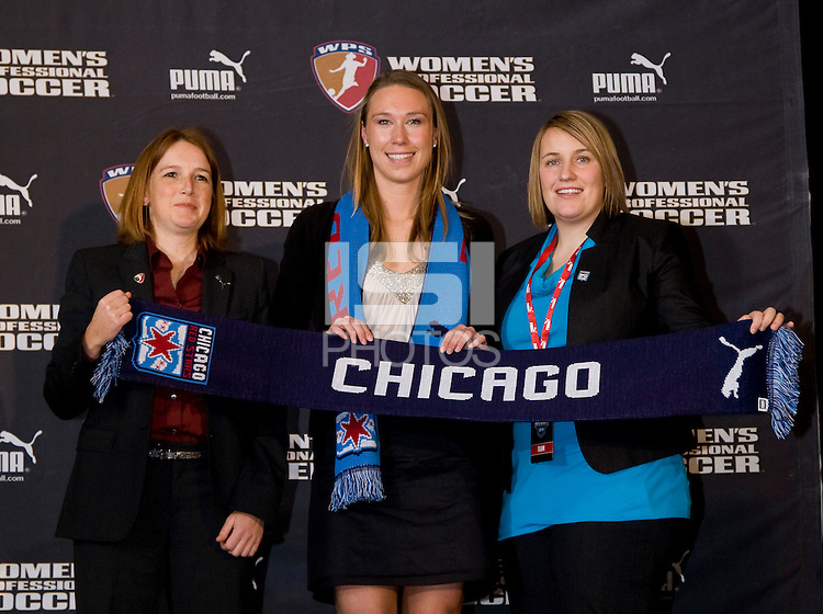 Whitney Engen takes the stage with WPS commissioner Tonya Antonucci  and Chicago Red Stars head coach Emma Hayes after being selected fourth overall by the Chicago Red Stars during the WPS draft at the Pennsylvania Convention Center in Philadelphia, PA.