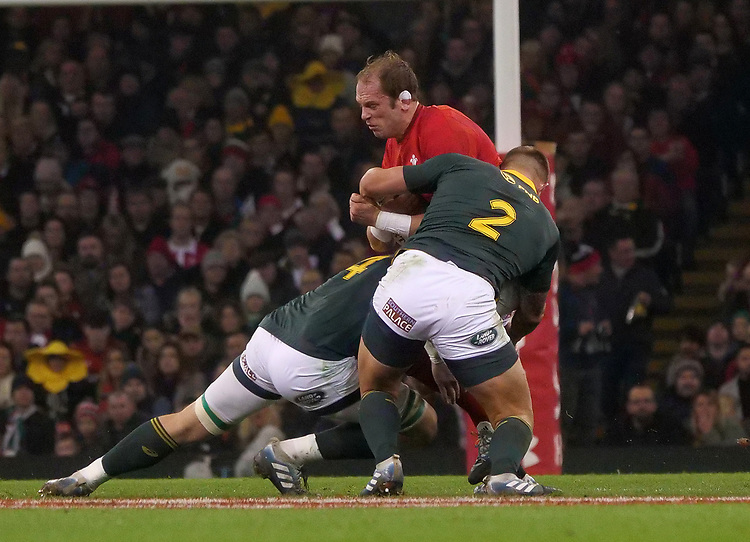 Wales' Alun Wyn-Jones is tackled by South Africa's RG Snyman and Malcom Marx<br /> <br /> Photographer Ian Cook/CameraSport<br /> <br /> Under Armour Series Autumn Internationals - Wales v South Africa - Saturday 24th November 2018 - Principality Stadium - Cardiff<br /> <br /> World Copyright © 2018 CameraSport. All rights reserved. 43 Linden Ave. Countesthorpe. Leicester. England. LE8 5PG - Tel: +44 (0) 116 277 4147 - admin@camerasport.com - www.camerasport.com
