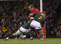 Wales' Alun Wyn-Jones is tackled by South Africa&rsquo;s RG Snyman and Malcom Marx<br /> <br /> Photographer Ian Cook/CameraSport<br /> <br /> Under Armour Series Autumn Internationals - Wales v South Africa - Saturday 24th November 2018 - Principality Stadium - Cardiff<br /> <br /> World Copyright &copy; 2018 CameraSport. All rights reserved. 43 Linden Ave. Countesthorpe. Leicester. England. LE8 5PG - Tel: +44 (0) 116 277 4147 - admin@camerasport.com - www.camerasport.com