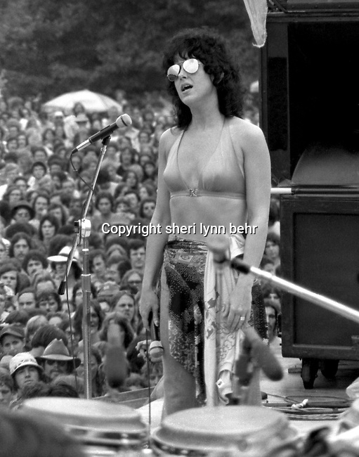 Grace Slick is performing onstage at a free Jefferson Starship concert in Central Park in  July, 1976.