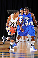 12 January 2012:  FIU guard Jerica Coley (22) handles the ball while being defended by Middle Tennessee State guard Shanice Cason (5) in the first half as the Middle Tennessee State University Blue Raiders defeated the FIU Golden Panthers, 74-60, at the U.S. Century Bank Arena in Miami, Florida.