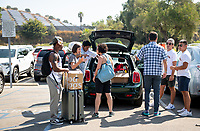 Incoming first-years and their families are welcomed by enthusiastic O-Team members and other members of the community during Occidental College's Fall move-in and orientation for the class of 2023, Aug. 22, 2019.<br /> (Photo by Marc Campos, Occidental College Photographer)