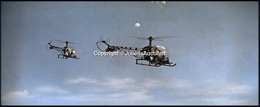 BNPS.co.uk (01202 558833)<br /> Pic: JuliensAuctions/BNPS<br /> <br /> ***Please Use Full Byline***<br /> <br /> The helicopter props used in the James Bond film, You Only Live Twice. <br /> <br /> Est: &pound;200,000.<br /> <br /> The iconic micro-jet flown by Roger Moore in Octopussy and the swivel chair used by super-villain Blofeld are among a host of props from James Bond movies coming up for sale.<br /> <br /> The 12ft long BD-5J red, white and blue aircraft, that is the world's lightest jet, was piloted by 007 in the opening scenes of Octopussy, outwitting his Cuban captors.<br /> <br /> The aircraft was actually built seven years before the film as part of an air display team and was hired for the 1983 Bond flick.