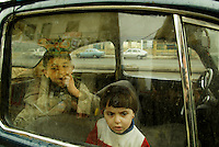 Baghdad, Iraq, Feb 18, 2003.Children waiting for their father in a 1967 Volkswagen beetle.