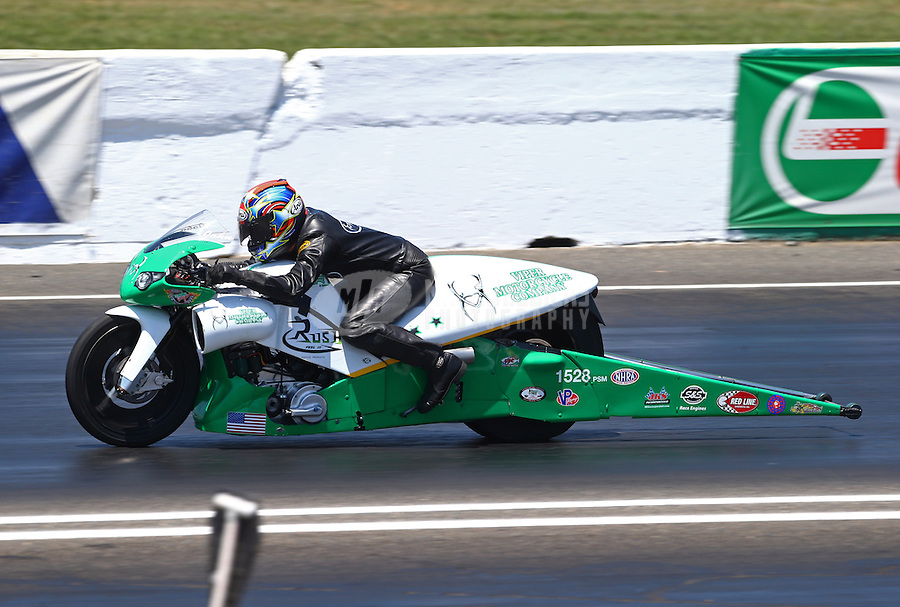 Jun. 1, 2013; Englishtown, NJ, USA: NHRA pro stock motorcycle rider John Hall during qualifying for the Summer Nationals at Raceway Park. Mandatory Credit: Mark J. Rebilas-