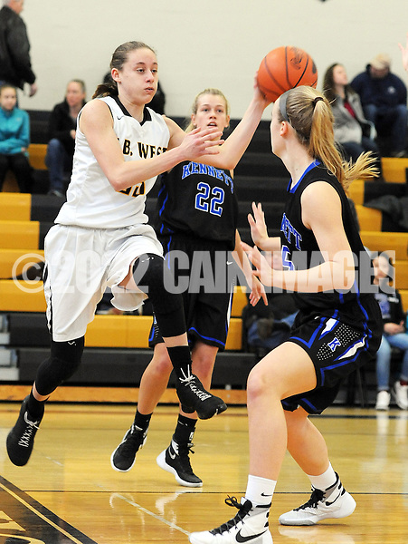 Central Buck's West's Tori Abelson #23 makes a pass as Kennett's Caroline Hertz #5 defends in the first quarter Saturday February 13, 2016 at Central Bucks West High School in Doylestown, Pennsylvania. Central Bucks West won 53-38. (Photo by William Thomas Cain)
