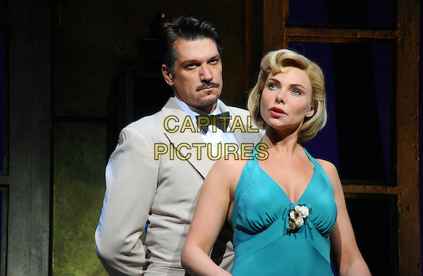 Samantha Womack & Paulo Szot on stage at 'South Pacific' photocall held at the Barbican Centre,.London, England..August 22nd, 2011.stage play half length goatee facial hair blue green halterneck dress white jacket.CAP/CJ.©Chris Joseph/Capital Pictures.