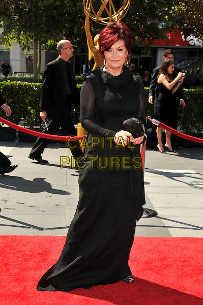SHARON OSBOURNE .61st Annual Creative Arts Emmy Awards held at Nokia Theatre LA Live, Los Angeles, California, USA, .12th September 2009..emmys full length long maxi dress black long sleeves sleeved clutch bag ring .CAP/ADM/BP.©Byron Purvis/Admedia/Capital Pictures