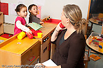 Education preschool 3-4 year olds female adult observer in classroom interacting with children education specialist