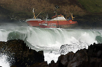 The French Trawler 'Pors Piron' which ran aground at the mouth of Dingle Harbour in the early hours of Sunday morning and resulted in the rescue of 8 fishermen pictured embedded on the rocks.<br /> Photo: Don MacMonagle