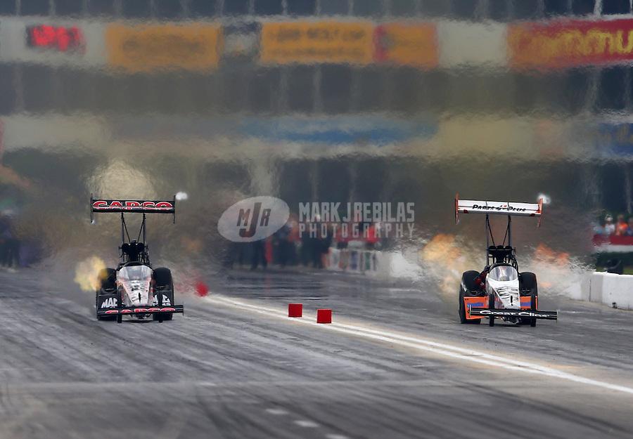 Apr 26, 2015; Baytown, TX, USA; NHRA top fuel driver Steve Torrence (left) races alongside Clay Millican during the Spring Nationals at Royal Purple Raceway. Mandatory Credit: Mark J. Rebilas-