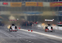 Apr 26, 2015; Baytown, TX, USA; NHRA top fuel driver Steve Torrence (left) races alongside Clay Millican during the Spring Nationals at Royal Purple Raceway. Mandatory Credit: Mark J. Rebilas-