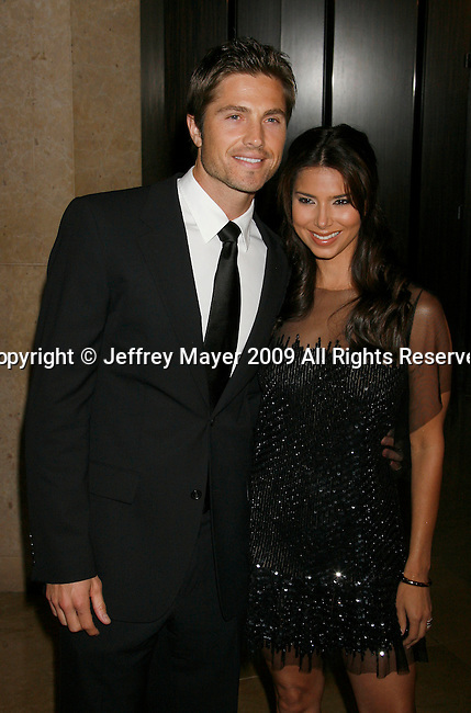 BEVERLY HILLS, CA. - October 02: Eric Winter and wife Roselyn Sanchez arrive at Operation Smile's 8th Annual Smile Gala at the Beverly Hilton Hotel on October 2, 2009 in Beverly Hills, California.