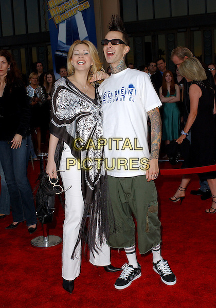 SHANNA MOAKLER & TRAVIS BARKER.The 33rd Annual American Music Awards held at The Shrine Auditorium in Los Angeles, California.  .November 22nd, 2005.Ref: DVS.AMA's full length married husband wife sunglasses shades tattoos shawl wrap green cropped trousers white t shirt.www.capitalpictures.com.sales@capitalpictures.com.Supplied By Capital PIctures