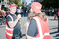 Men purporting to be media wear Trump campaign paraphernalia and MAGA hats before the Straight Pride Parade in Boston, Massachusetts, on Sat., August 31, 2019. The parade was organized in reaction to LGBTQ Pride month activities by an organization called Super Happy Fun America.