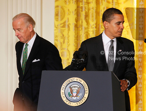Washington, DC - February 20, 2009 -- United States President Barack Obama, right, and Vice President Joe Biden, left, leave the stage after addressing mayors from across the United States,  in the East Room of the White House, Washington, DC, Friday February 20, 2009..Credit: Aude Guerrucci - Pool via CNP
