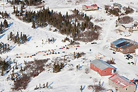 Aerial of teams resting outside the community center at Koyuk in Arctic Alaska during the 2010 Iditarod