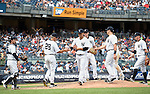 (L-R) Joe Girardi, Masahiro Tanaka (Yankees), JULY 23, 2015 - MLB : New York Yankees starting pitcher Masahiro Tanaka (C) hands the game ball to Manager Joe Girardi (second left) after being relieved in the eighth inning during a baseball game against the Baltimore Orioles at Yankee Stadium in New York, United States. (Photo by AFLO)
